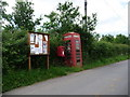 ST7707 : Woolland: postbox № DT11 100, phone and noticeboard by Chris Downer