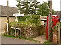 ST3703 : Thorncombe: finger-post and phone by Chris Downer