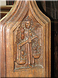 TM1994 : St Mary's church - C15 carved bench end (restored) by Evelyn Simak