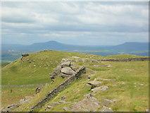 SD7659 : Rocks on Whelp Stone Crag by John H Darch