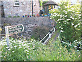 NY7808 : Footpath in Hartley village by Stephen Craven