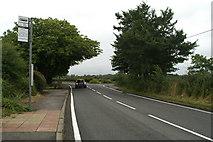SJ6298 : Byrom Lane bus stop on Slag Lane by David Long