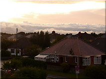 SZ0894 : Ensbury Park: a bungalow and clouds by Chris Downer