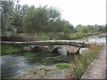 SP1106 : Old bridge over the River Coln at Bibury by Sarah Charlesworth