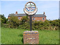 TG4700 : Fritton Village Sign by Adrian Cable