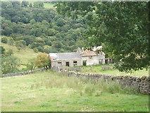 SK2276 : Tumbledown barns near Eyam by Peter Barr