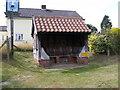 TM4160 : Friston Bus Shelter & Friston Village Sign by Geographer
