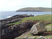 NC0327 : Erratic boulder at the sea edge by Gordon Hatton