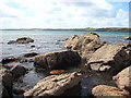 SW9037 : Rocks at the east end of Carne beach by Rod Allday