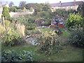 NZ1716 : A domestic garden in Waters End by Stanley Howe