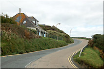 SM8422 : Looking north on the A487 up the hill out of Newgale by Andy F