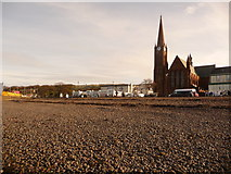 NS2059 : Largs: the beach and the church of St. Columba by Chris Downer