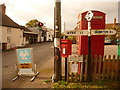 ST7928 : Milton on Stour: finger-post, phone box and postbox by Chris Downer