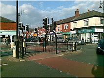 SJ8993 : Traffic islands, in Houldsworth Square by Geoff Royle