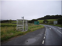 NR8261 : Bus stop and shelter on A83 near Redhouse by PAUL FARMER