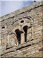 NZ0461 : Bywell St. Andrew - upper part of tower (west face) by Mike Quinn