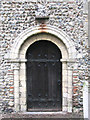 TM1596 : St Nicholas' church - the Norman south doorway by Evelyn Simak