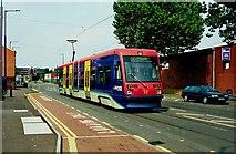 SO9297 : Midland Metro tram no. 12 in Bilston Road by P L Chadwick