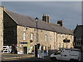 NY9864 : The Co-op and the Golden Lion, Hill Street by Mike Quinn