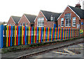 TM1686 : Colourful fence surrounding Tivetshall Primary School by Evelyn Simak