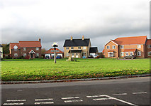 TM1686 : New houses by the village green by Evelyn Simak