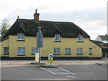 SX9896 : Thatched cottage at a T-junction in Dog Village by Sarah Charlesworth