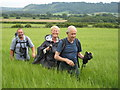 SE7390 : Happy walkers approaching Lastingham by Philip Barker