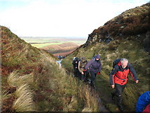 NZ5812 : Walkers approaching the Cleveland Way by Philip Barker