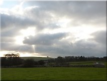 SK1862 : Woodside Farm under a ray of sunlight by Peter Barr
