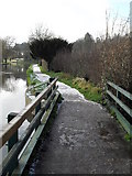 SU9948 : Melting snow by the sluice bridge by Basher Eyre