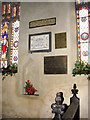TF6806 : St Martin's church - memorial tablets in south aisle by Evelyn Simak