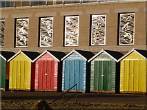 SZ1191 : Boscombe: colourful beach huts and bird-shaped metalwork by Chris Downer