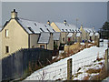 NG2547 : Houses in Dunvegan by Richard Dorrell