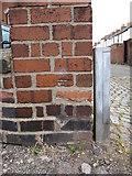SJ4065 : Damaged bench mark in Meadows Lane by John S Turner