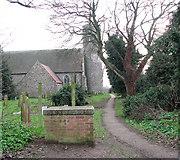 TG4802 : All Saints church, Belton - footpath through churchyard by Evelyn Simak