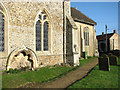 TL7698 : All Saints church - tomb recess in south aisle wall by Evelyn Simak