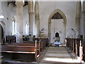 TL7698 : All Saints church - view west by Evelyn Simak