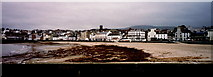 SC2484 : Peel - Beach and waterfront buildings in distance by Joseph Mischyshyn