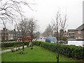 TQ3971 : Garden of St Barnabas church, Downham by Stephen Craven