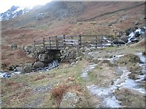 NY3614 : Footbridge over Nethermost Beck by K  A