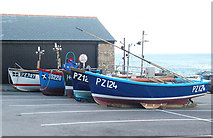 SW3526 : Fishing boats on a car park at Sennen Cove by Andy F