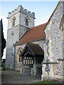 TL9383 : St Mary's church - tower and porch by Evelyn Simak