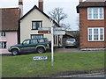 TM1763 : Old Road Sign B1077 High Street, Debenham by Geographer