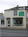 SE1527 : Wyke Opticians - Towngate by Betty Longbottom