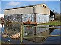 TF5703 : Flooded yard at Wash Farm by Evelyn Simak