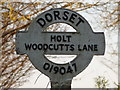 SU0104 : Holt: detail of Woodcutts Lane signpost by Chris Downer