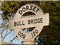 SU0211 : Wimborne St. Giles: detail of Bull Bridge finger-post by Chris Downer