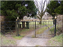 TM3569 : The Gates to Peasenhall Cemetery by Geographer