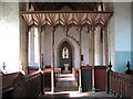 TL9991 : All Saints church in Snetterton - view west through rood screen by Evelyn Simak