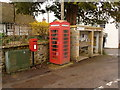 SY4799 : Netherbury: postbox № DT6 76 and phone by Chris Downer